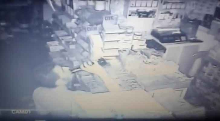 CCTV footage shows the thief drinking juice before robbing the supermarket. (YouTube)
