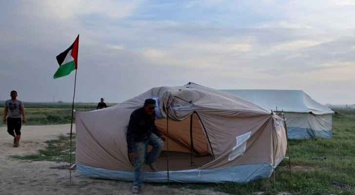 Palestinians set up tents in preparation for mass demonstrations along the Gaza strip border