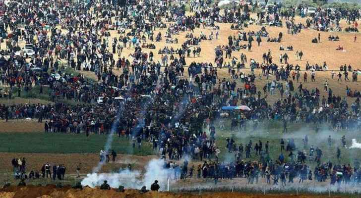 """Palestinians demonstrating near the Gaza borders during the """"Great Return March"""""""