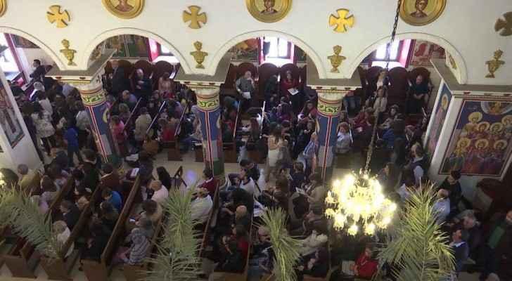 Jordanians are performing Palm Sunday mass. (Roya)