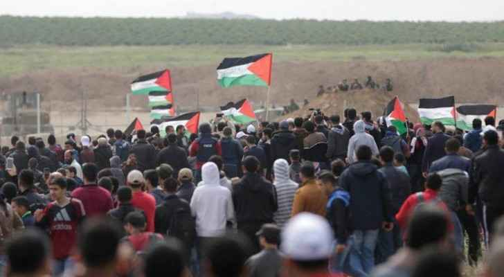 Palestinians demonstrating near the Gaza border fence