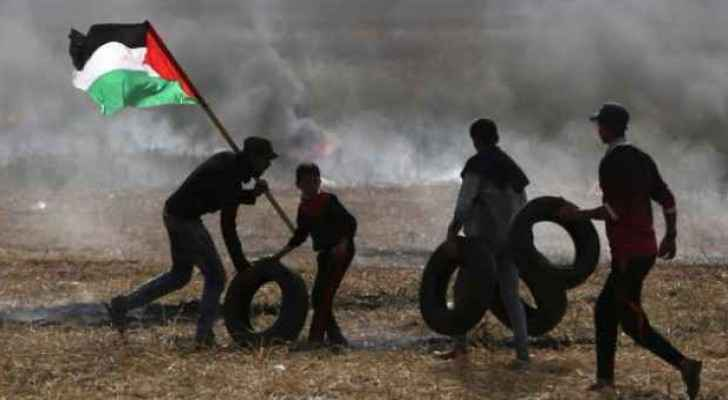 "Palestinians burning tyres during the ""Tyre Burning Friday"""