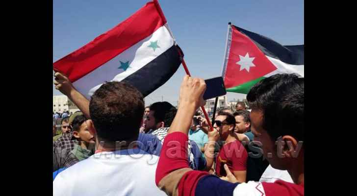 Jordanians and Syrians during the protest against US-led airstrikes in Syria.