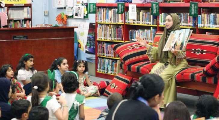 Children attentively listen to Ghadeer Yamani. (AN photo)
