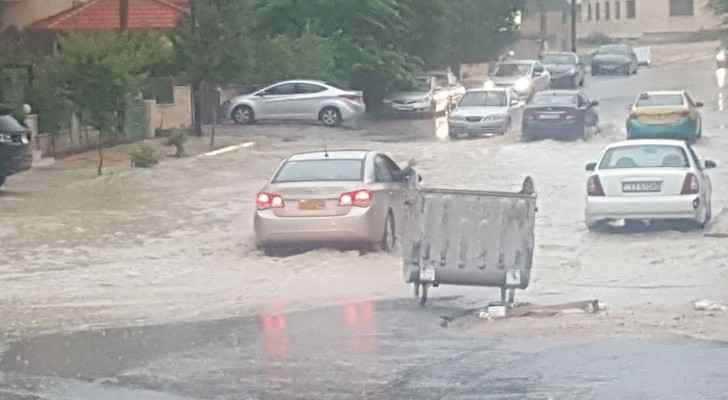 Heavy rain floods the roads in Amman. (Roya)