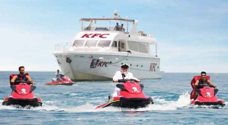 KFC's Colonel Sanders rode onto Kite Beach on a jet ski, like a boss. (WhatsOn)