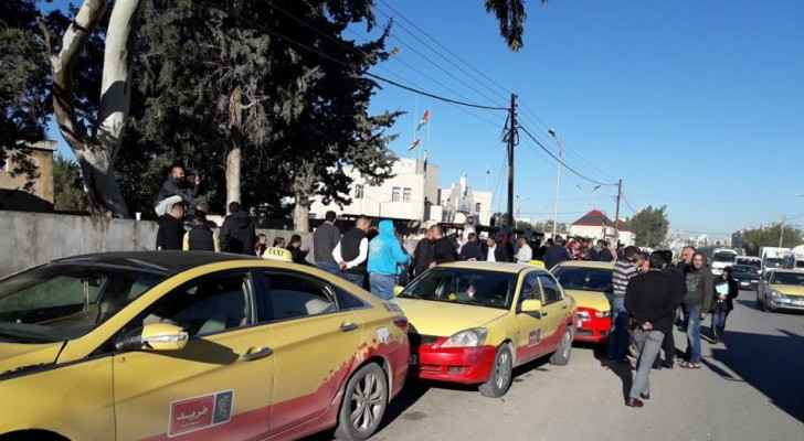Taxi drivers  stood in protest of ride-hailing apps.