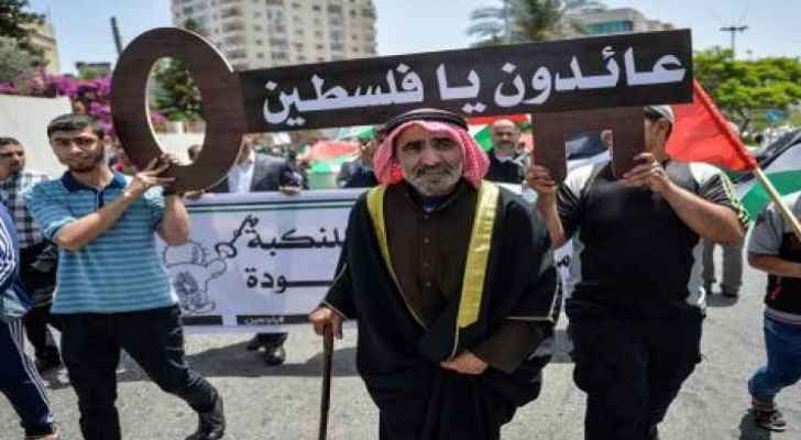 """The key reads  """"Oh Palestine we are coming back"""""""