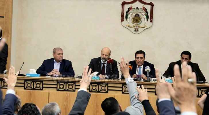 PM Omar Razzaz (center left) during the meeting with MPs. (Roya)