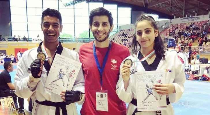 Taekwondo champions Natalie Hamidi and Fahed Ammar with Coach Laith Izzat