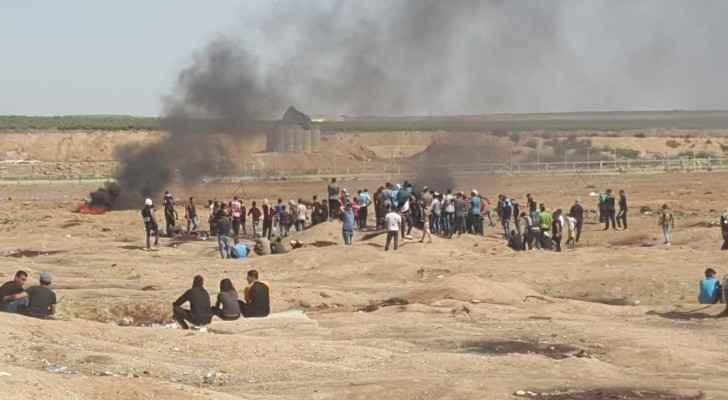 Gazans near the border fence on June 22.