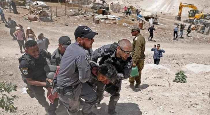 Israeli forces remove one of the protestors in Khan Al-Ahmar village on Wednesday. (Roya Arabic)
