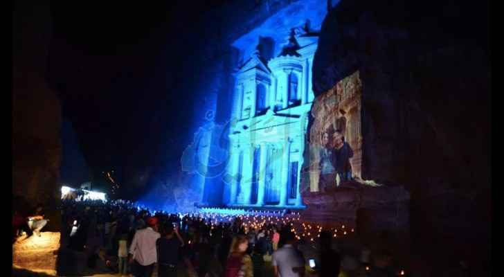 Petra lit up by candles and blue lights. (Al Rai)