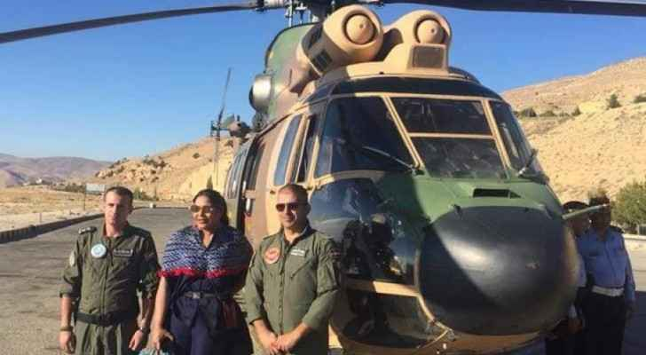 Ahlam posing next to the military helicopter. (Alkhaleejonline.net)
