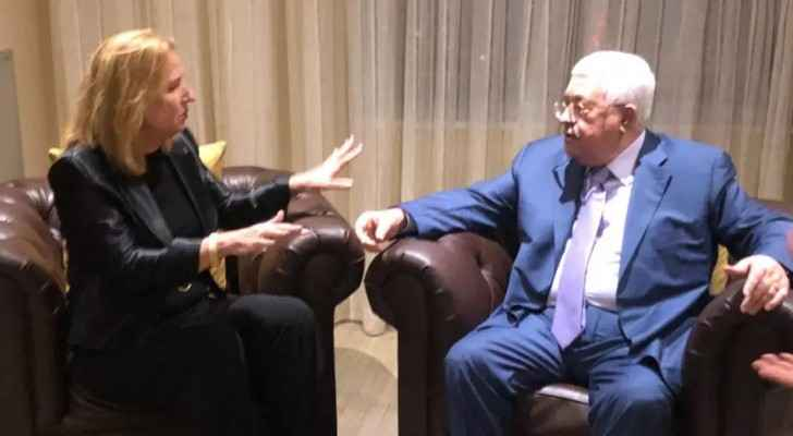 Tzipi Livni speaks with Mahmoud Abbas in New York City in a picture released Wednesday, September 26, 2018. (The JPost/Courtesy)