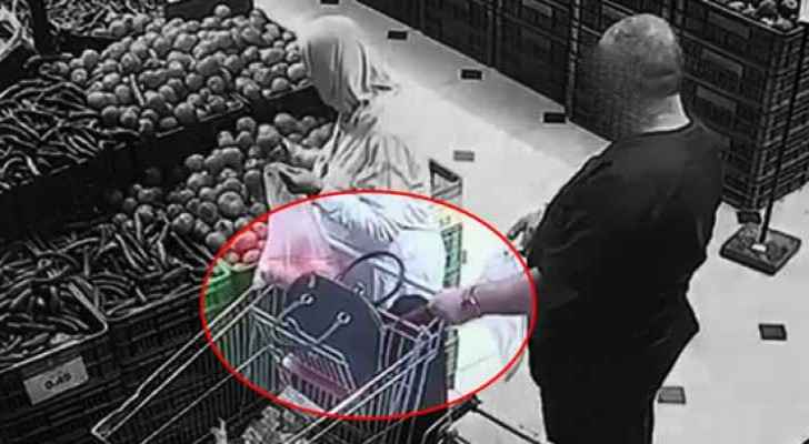 Still from the video footage showing the moment of theft in a supermarket