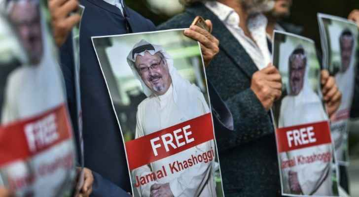 Activists carrying poster reading: Free Jamal Khashoggi (AFP / OZAN KOSE)
