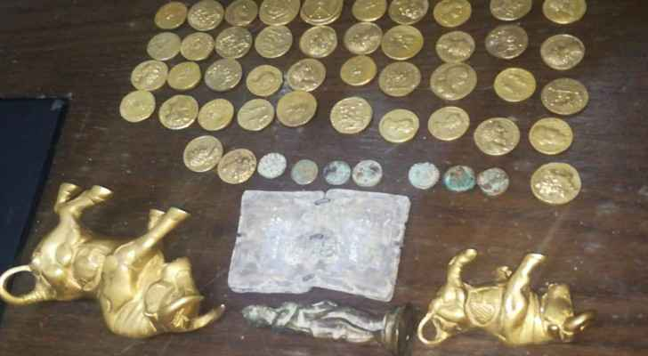 Three golden statues, a book made of copper, 43 gold coins and seven small bronze coins.
