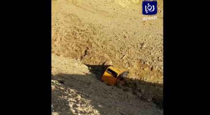 Video Screenshot: school bus in valley, Madaba-Dead Sea road.