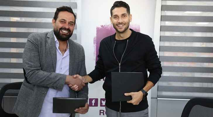 Imad Farajin and Fares Sayegh seal the deal. (Roya)