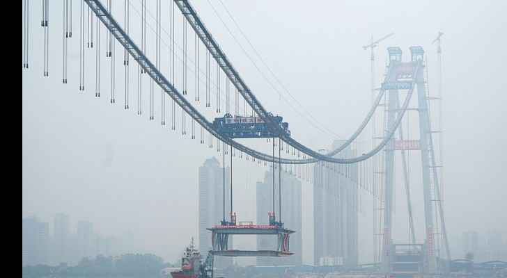 China: World's longest double-deck bridge under construction