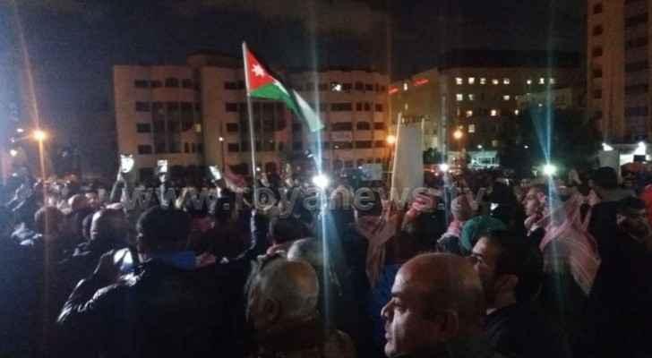 Dozens of Jordanians protested near the Fourth Circle on Thursday. (Roya)