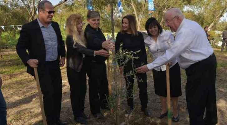 Israelis and Jordanian Embassy staff plant trees in Baqoura in memoriam of killed Israeli girls