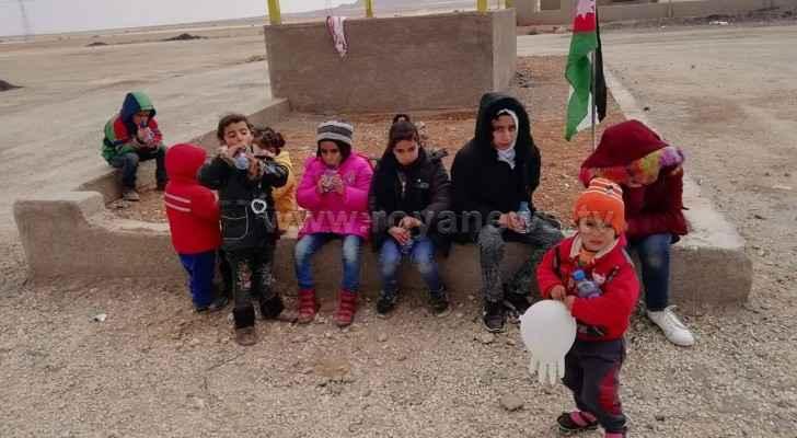 Jordanian professor walks with his small children from Tafila to Amman