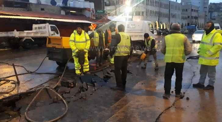 GAM mending Downtown damaged street