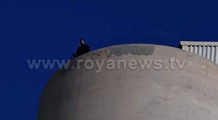 Video: Man threatens to jump off silo in Irbid