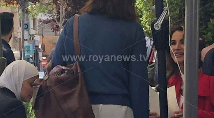 Roya cameras capture photos of Queen Rania while sitting in a cafe