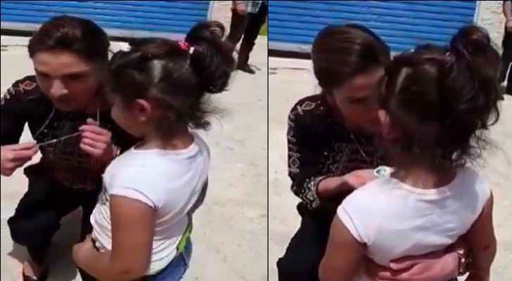 Queen Rania gifts necklace to young girl in Karak