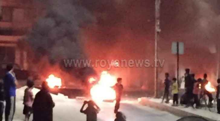 Rioters block road in Irbid with burning tires
