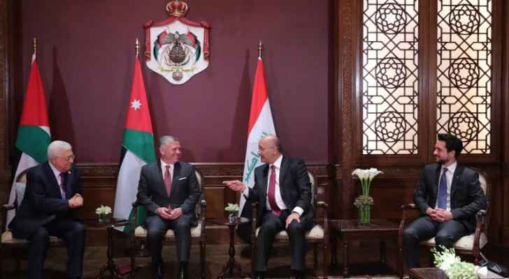King holds trilateral meeting with Iraqi, Palestinian presidents