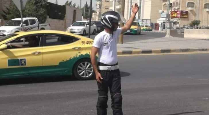 Traffic police officers wear white T-shirts instead of usual uniform on accession to throne day