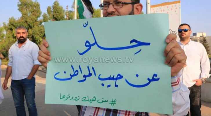 Citizens protest against fuel tax near 6th circle in Amman