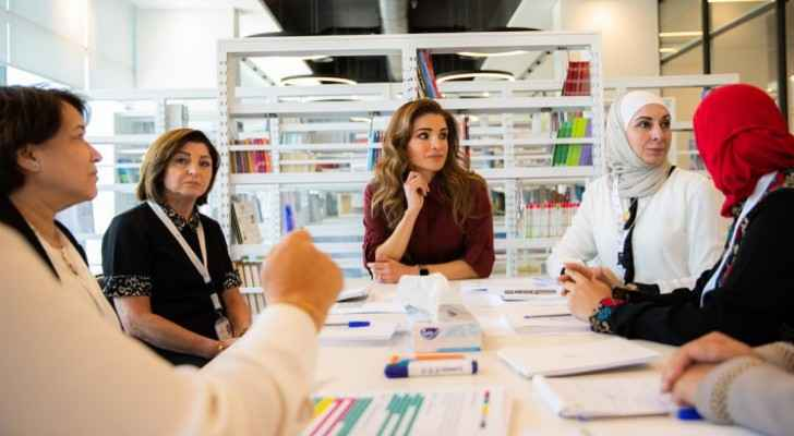 Queen Rania takes a look at student projects during visit to Queen Rania Teacher Academy