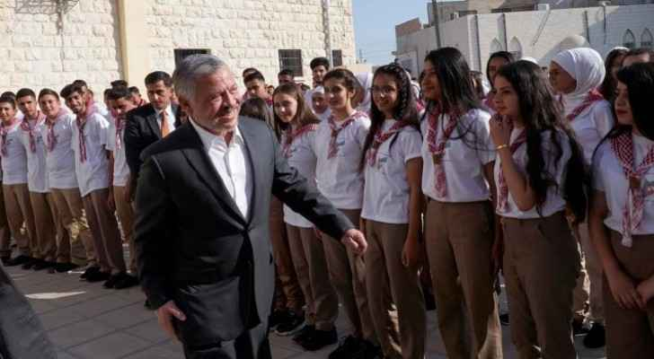 Video: King joins students in school morning queue in Al Hussein Secondary School for boys