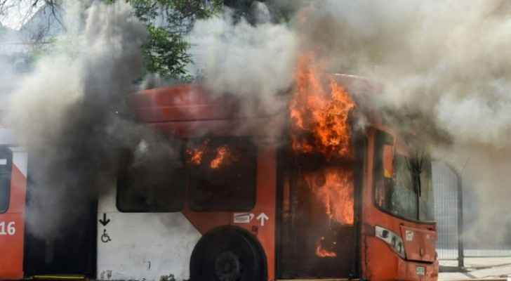Bus set on fire by rioters