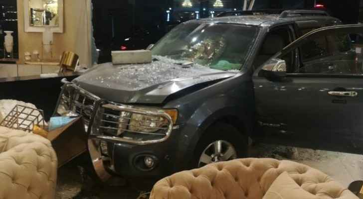 Photos: Car drives into furniture store in Amman