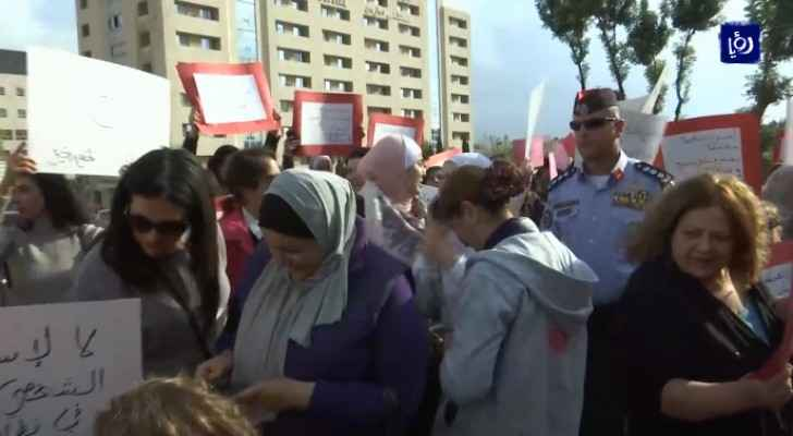 Members of Arab Women Organization organize protest against violence towards women