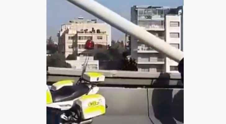Young man attempts to commit suicide by jumping off Abdoun Bridge in Amman