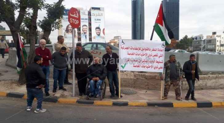 A number of people with disabilities organize protest in Amman