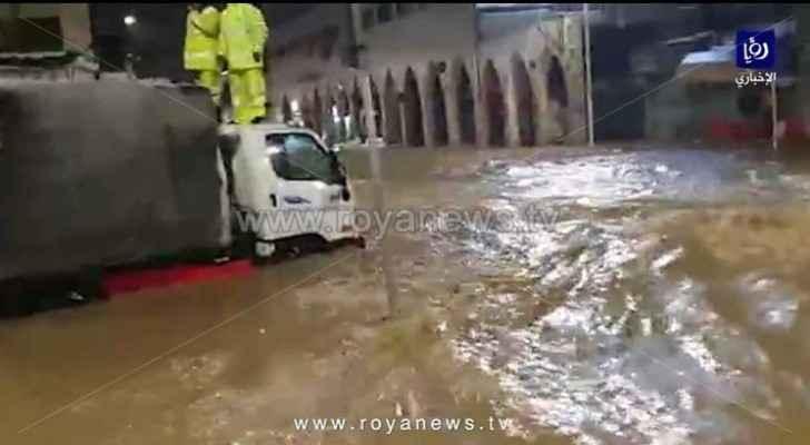 In Video: Rainwater raids shops in Downtown Amman