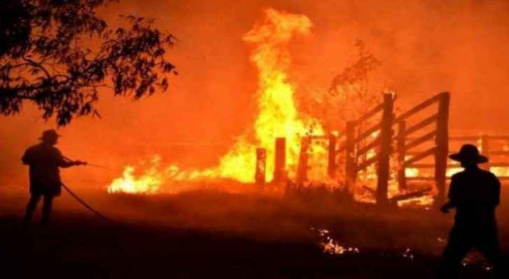 Firefighters trying to extinguish bushfires in Australia
