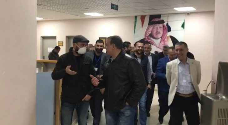 Mohammad Al Hyari accompanied by the Health Minister as he leaves quarantine