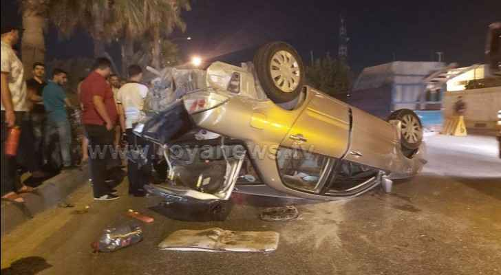 Car flips in major road accident in Amman