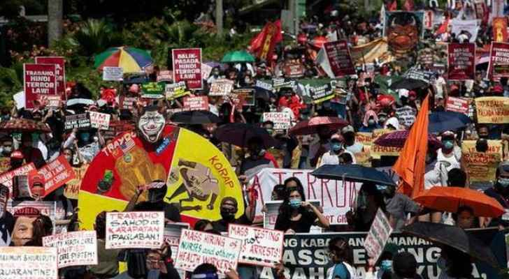 Protester march in Manila. Photo credit: Reuters.