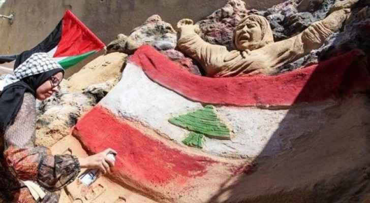 Palestinian woman stands in solidarity with Lebanese following catastrophe