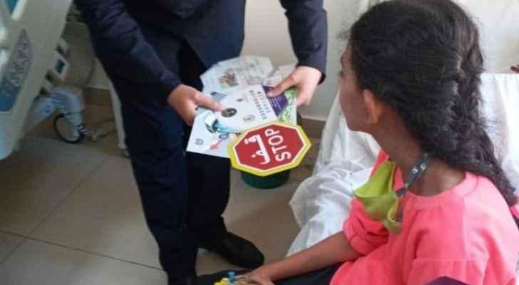 Traffic officers visit girl at Princess Rahma hospital